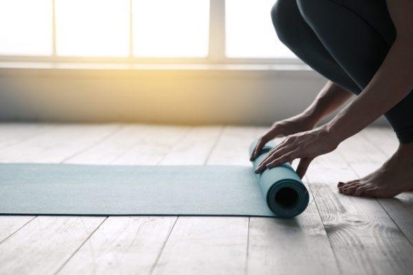 Unrolling a yoga mat